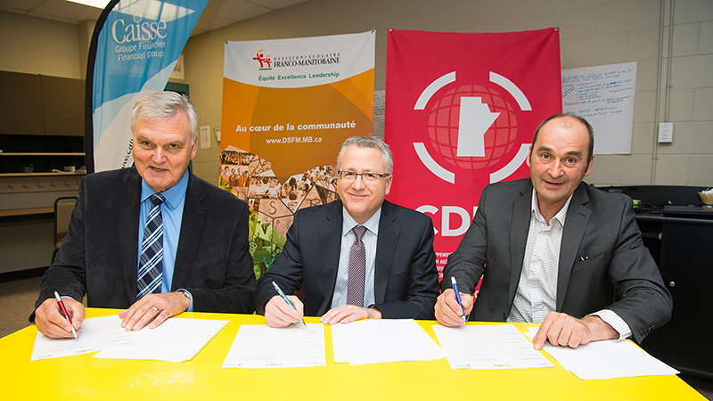 Edmond Labossière, President of CDEM's Board of Directors, Joël Rondeau, Executive Director of Caisse Financial Group and Bernard Lesage, President of the Commission scolaire franco-manitobaine (CSFM).