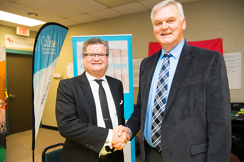 Stéphane Dorge, Vice-President Caisse Financial Group Board of Directors, and Edmond Labossière, President of CDEM's Board of Directors.