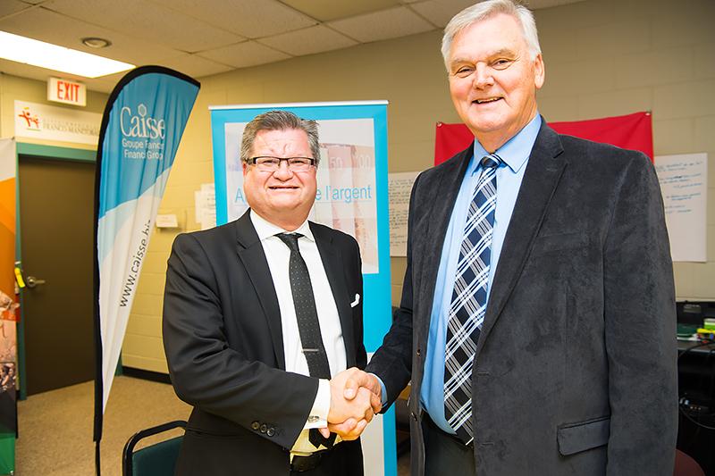 Stéphane Dorge, vice-président du Conseil d'administration de Caisse Groupe Financier, et Edmond Labossière, président du Conseil d'administration du CDEM.